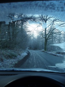inside a car dirving along a frosty winter english lane